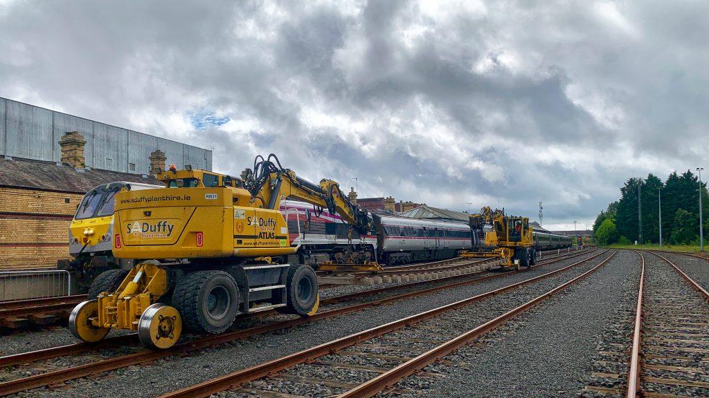 2 Atlas machines at work on rail line